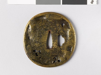 Tsuba with plants and landscape scene