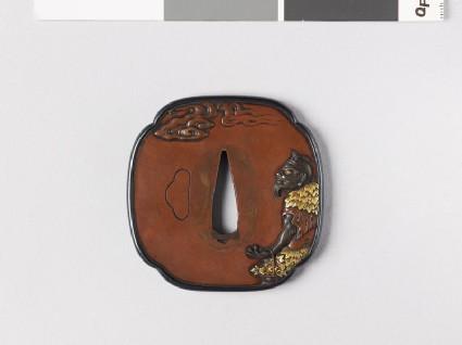 Mokkō-shaped tsuba depicting a sennin, or Taoist hermit, carrying a peony flower in a basket