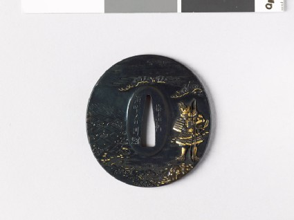 Tsuba depicting an armed warrior standing by the sea