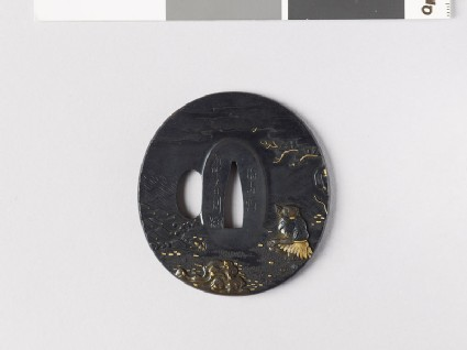 Tsuba depicting a fisherman on a beach