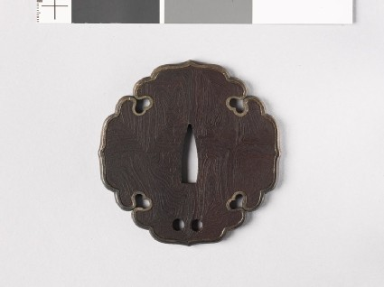 Aoi-shaped tsuba with silver rim