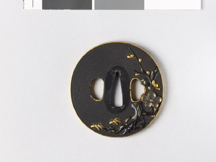 Tsuba with blossoming plum tree