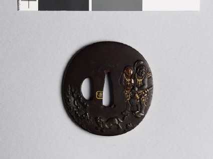 Lenticular tsuba with figures and a tiger in a landscape