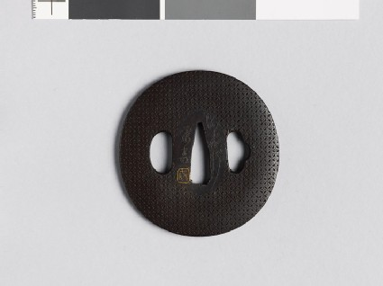Lenticular tsuba with shippō diaper of interlaced circles
