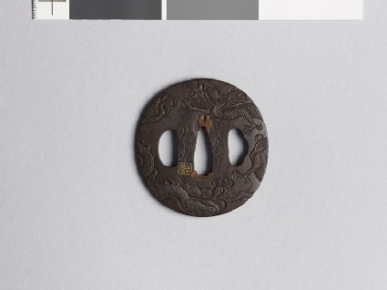 Lenticular tsuba with two dragons