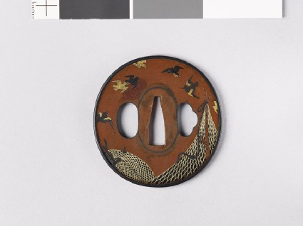 Tsuba depicting drying nets and birds