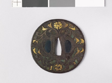 Round tsuba with flowers, foliage, and dragons