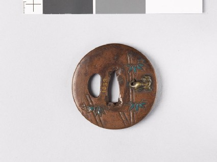 Lenticular tsuba with bamboo stems and tigers