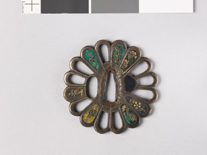Tsuba in the form of a chrysanthemum mon