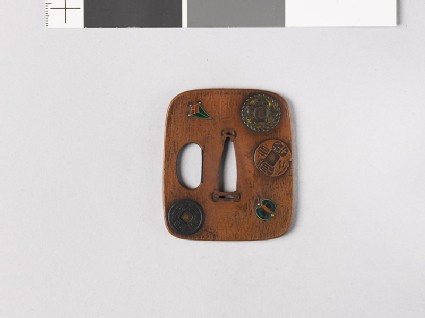 Aori-shaped tsuba depicting charms, coins, and three of the Seven Treasures