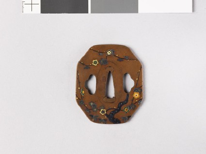 Octagonal tsuba with plum tree and ground bamboo