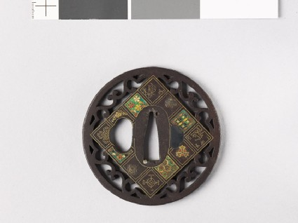 Round tsuba with flowers and scrolls