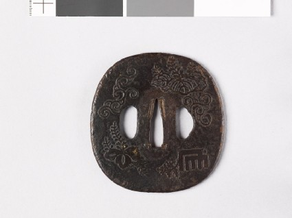 Tsuba with Genjimon and mon made from kiri, or paulownia leaves