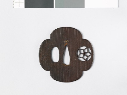 Mokkō-shaped tsuba with mon formed of a clematis flower in a circle