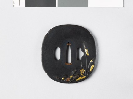 Mokkō-shaped tsuba with water lilies and a tree frog