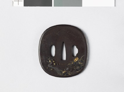 Tsuba depicting a a wild boar sleeping in a landscape
