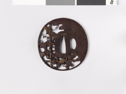 Tsuba with morning glory growing over a bamboo lattice