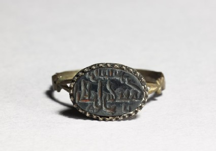 Oval seal ring with kufic inscription, a flower, and a star