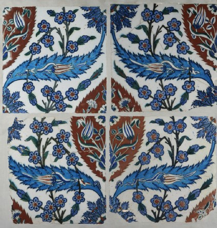 Set of four tiles with tulips, prunus sprays, and serrated leaves
