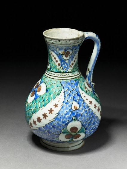 Jug with leaves and çintamani motif against a fish-scale background