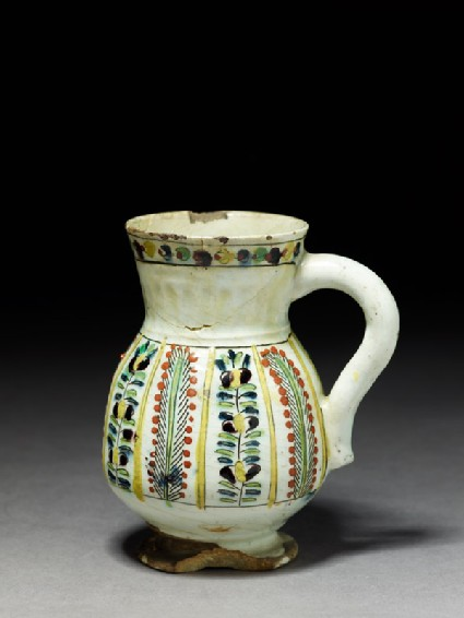 Jug with vegetal panels