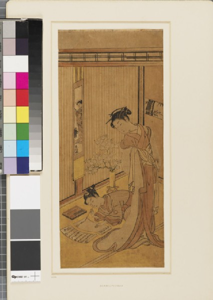 A girl watching a young man writing a letter