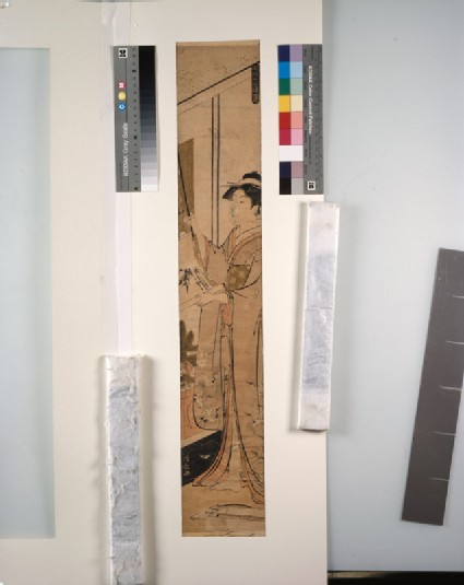 A woman hanging a scroll for the New Year