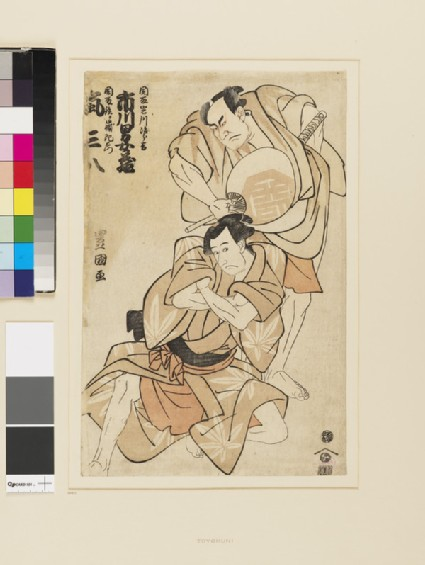 Ichikawa Omezō I holding a large fan and looking down over the shoulder of Arashi Sanpachi
