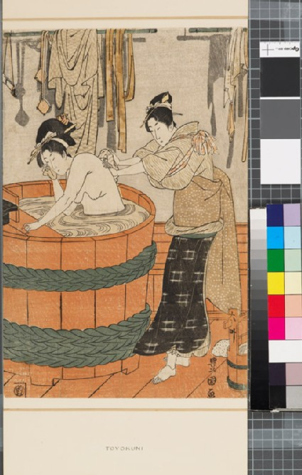 A bathing woman and a maid in a bath house