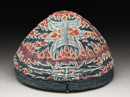 Cap with leaves and flowers