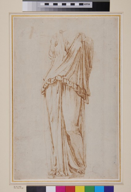 A headless statue of a draped standing female figure