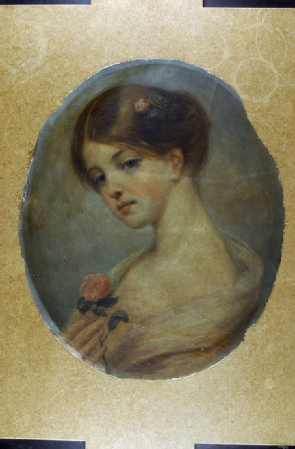 Head and shoulders of a Girl holding a Rose