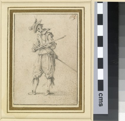 Man examining the lock of a musket