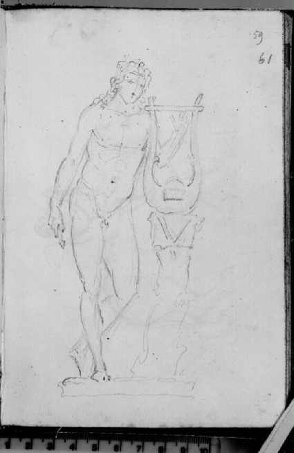 A standing male figure with a harp