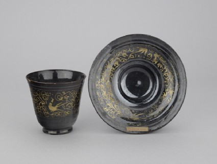 Saucer with decoration in gold and silver