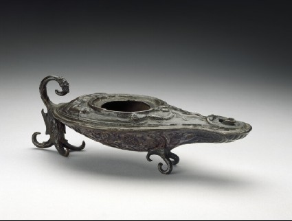 Oil-lamp in the form of a boat