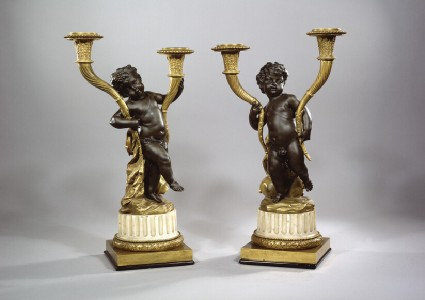 Candelabra in the form of revelling putti, one of a pair