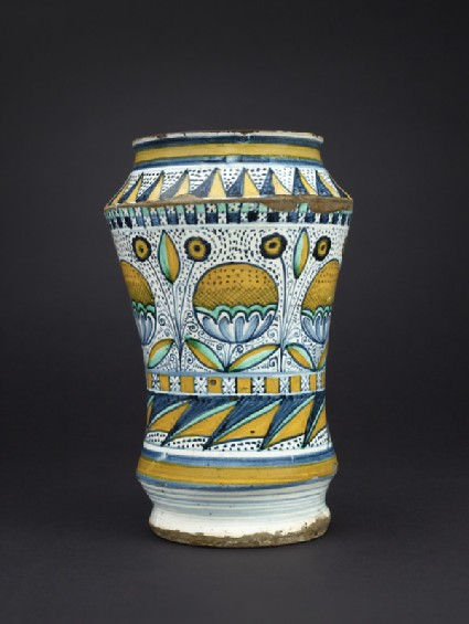 Albarello, or pharmacy jar, with flower heads and leaves