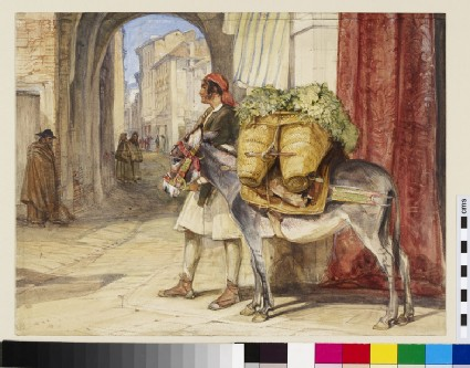 Spanish street scene, possibly Seville, with a man leading a laden donkey
