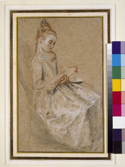 A girl seated with a book of music on her lap