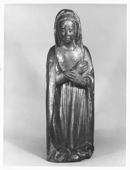 Virgin Mary kneeling in adoration