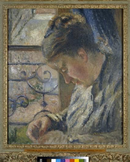 Julie Pissarro Sewing beside a Window
