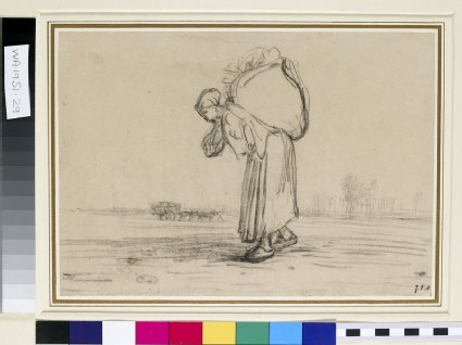 A woman carrying a sack on her back