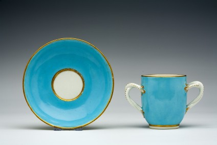 Cup, two-handled, and saucer