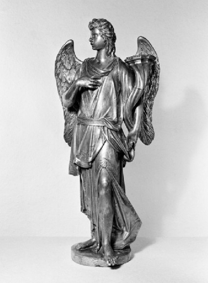 Candlestick in the form of an angel holding a trumpet