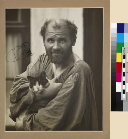 Gustav Klimt (1862-1918) holding a cat