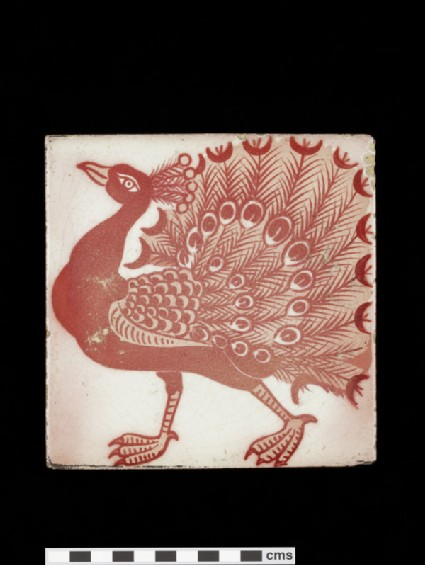 Tile with peacock walking to the left