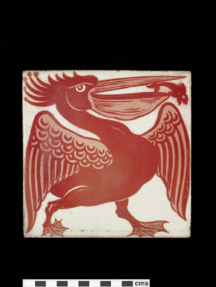 Tile with pelican walking to the right with small fish leaping out of his open beak