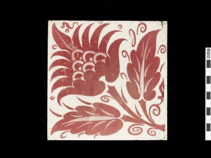 Tile with peony style flower and two leaves
