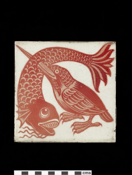 Tile with kingfisher with its beak thrust through a large fish